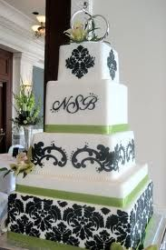 Stunning Damask wedding cake in black white with pops of green.