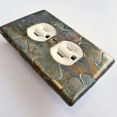 ginkgo outlet cover, craftsman switchplate, bronze patina. $20.00, via Etsy.