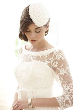 Love everything about this outfit from the stunning dress to the sweet fascinator!