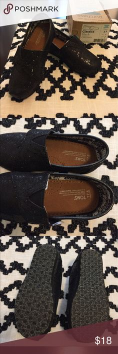 Toms Glitter black toddler size T 7.5 Toms Girls black Glitter size T 7.5. New without tags but box intact. Just triednon at home. TOMS Shoes Moccasins