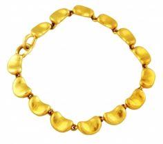 """Tiffany Elsa Peretti Gold Bean Bracelet  Tiffany & Co. 18K Yellow Gold  Elsa Peretti Bean Bracelet, 7"""" long,  20.6dwt.  Item Number: WOOO89"""