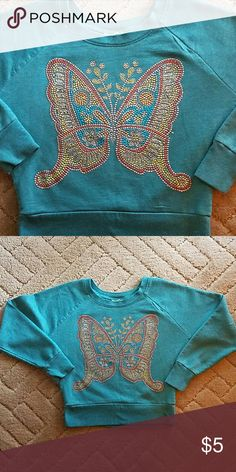 Gorgeous crop sweatshirt,Girls Small Super cute teal crop sweatshirt, great used condition, no missing rhinestones. Tag us cut out because it was itchy. Shirts & Tops Sweatshirts & Hoodies