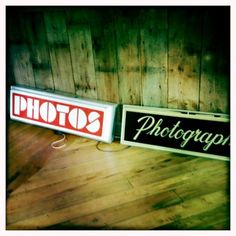 A few lighted top signs from vintage photo booths in our collection.
