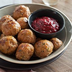 This Herbed Turkey Meatballs and Cranberry Barbeque Sauce recipe is a great appetizer for Thanksgiving. The Cranberry Barbeque sauce is to die for.