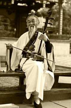Math and Music -- the TWO Wonderful Universal Languages that bring JOY around the world. -DdO:) Tongli musician, Suzhou, Jiangsu, China