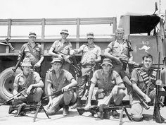 Heavily armed Australian Airfield Defence Guards at Phang Rang in 1971. The men are from No. 1 Section Airfield Defence Flight, which was attached to No. 2 Squadron RAAF. They are shown with the weapons and ammunition that they normally took with them on patrols around the airbase.