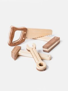 Lovely toy tool set made of Guatambu and Incense wood. Beautifully crafted heirloom quality toy.  Made in Argentina