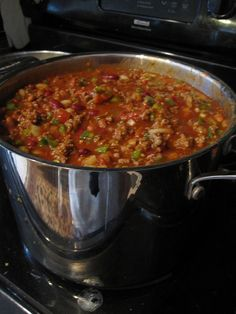 Wendy's Chili Recipe - Ingredients:  - 4.5 pounds ground beef  - 2 large yellow (sweet) onions, finely chopped  - 3 large green bell peppers, finely chopped  - 4 celery stalks, finely chopped  - 2 heaping tablespoons minced garlic  - 2 cans Ranch Style Beans, NOT drained (15 oz cans)  - 2 cans dark red kidney beans, drained (15 oz cans)  - 2 cans Original Rotel Diced Tomatoes & Green Chili (10 oz cans)  - 2 cans stewed tomatoes (15 oz cans)  - 4 cans plain tomato sauce (15 oz cans)  - 2…