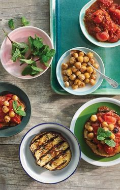 Smoky Grilled Chickpeas with Eggplant and Tomatoes // This easy vegan dish is packed with some great summer flavors. Cooking chickpeas in a dry skillet right on the grill makes them deliciously crisp on the outside and creamy inside. These make a wonderful after-work or after-school snack!