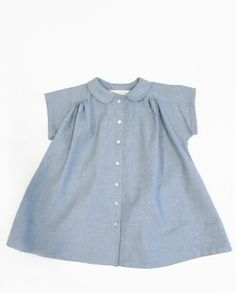 the wolfechild prairie dress is lightweight cotton chambray dress. This relaxed fit dress features a peter pan collar, button down closure at center front and gathered detailing at front and back.  composition: 100% cotton