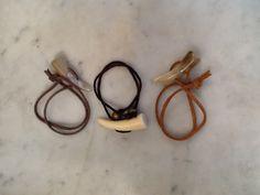 tusk and leather bracelet