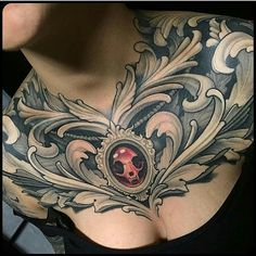Filigree & Skull Chest Piece by @corpsepainter at Corpsepainter Tattoo in…