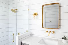 Step into a bathroom to admire white shiplap bathroom walls continuing into a glass enclosed shower with an antique brass rain shower head. Shiplap Bathroom Wall, Washroom, Bathroom Canvas, Bathroom Furniture, Shower Alcove, Shower Rooms, Shower Walls, Shower Bathroom, Shower Backsplash