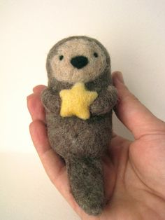 Needle Felted Sea Otter with Starfish - Stocking Stuffer. $33.00, via Etsy.