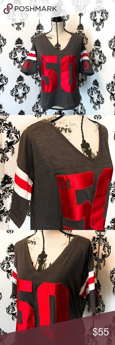 "NWT! 🍀 Limited Edition Victorias Secret Utes top! This Limited addition Victoria's Secret jersey style crop top is so much fun & super cute! What A great way to show your ram pride! The 50 on the front is a shiny silk material that really makes it stand out! the sleeves are a jersey style sleeve with white and red stripes with the Utah Utes logo on each sleeve! The back says ""Love Pink"" this shirt is super cute on! Watch the game looking so cute and supportive with this amazing top! It's…"