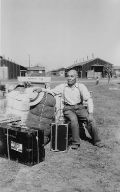 An unidentified resident of Topaz is shown with the few possessions he was able to take into the internment camp in 1942. Japanese Americans living along the West Coast lost most of their property
