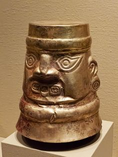 Gold vessel with human face Sican Peru 850-1250 CE by mharrsch, via Flickr