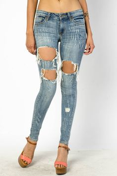 EXTRA DISTRESSED DENIM SKINNIES $30.99