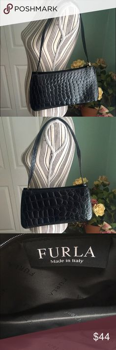 🔥Authentic Furla Leather Crocodile Shoulder Bag This authentic black crocodile pattern leather bag is Furla, made in Italy.   Shoulder strap measures 12 inches from top point to gold Furla hardware.   Dimensions are 12 inches by 7 inches by 3.5 inches.  Excellent condition. No stains, debris or holes in lining, no holes or cracking/peeling exterior.   Own designer bag at an affordable price!  10% bundle discount in my closet 💕💕 Furla Bags Shoulder Bags