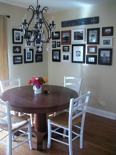 I like the white chairs- I painted my chairs white with a walnut seat, and painted the table legs black, with a walnut stain top... this was my inspiration.