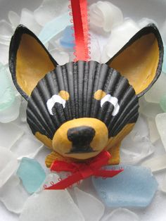 This adorable, carefully hand painted Chihuahua is made entirely of seashells, most of which I collected myself from my favorite Cape Cod beach. The face is a scallop shell, nose a slipper shell and ears are made of mussel shells. Perfect for dog and beach lovers! I use acrylic paint then finish it with an acrylic sealer for shine and protection. Thanks for having a look! © Lori Muir, 2012