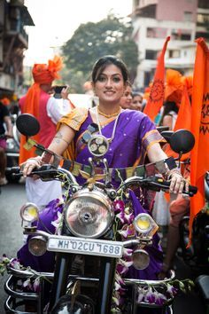 A Marathi woman displays her biking skills during Gudi Padwa. Festivals Of India, Amazing India, India People, India And Pakistan, Biker Girl, People Of The World, India Beauty, World Cultures, Portrait