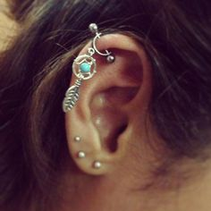 Fab dream-catcher helix piercing. on The Fashion Time http://thefashiontime.com/5-cute-fun-ear-piercing-ideas/#sg5