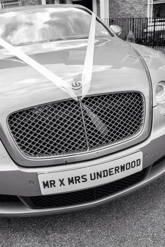 Our wedding car wedding ribbon with personalised plate