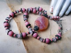 Beaded Choker - Doubles as Bracelet - Agate Focal - Pink Glass, Red & White Stripes. Dark Metal - Rustic Beaded Necklace. $42.00, via Etsy.
