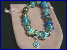 Super Sale!! Reg. $30.00....enjoy the savings!!Beads and bracelet are imported from Thailand, but crafted in the USA! Lot cc-16 Contact me for my previous logo style jewelry such as brooch, bracelet,