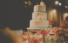 White Roses made with sugar embellishing the wedding cake containing the traditional something blue with the stripes