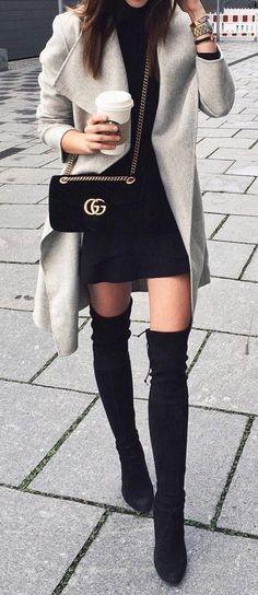 Light gray coat over black dress & OTK boots.