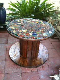 DIY Furniture - mosaic table, made from an old cable spool and broken dishes from dollar tree