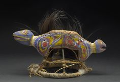 New Guinea    Double bird head with cassowary feathers   Wood, feathers 11.5 x 16.5 x 8.5 inches 29.2 x 41.9 x 21.6 cm NG 168