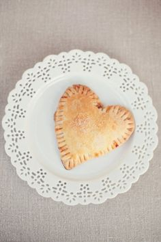 """""""Heart shaped pastry---Isn't that lovely? On a related note, I love the plate--it looks like a doily but isn't, that's a great idea."""""""