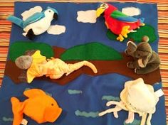 Finally something I made! I used this Land Air Water mat with 2 1/2 to 3 year olds with Beanie Babies.  But it could also be used with real objects.  Made of felt.