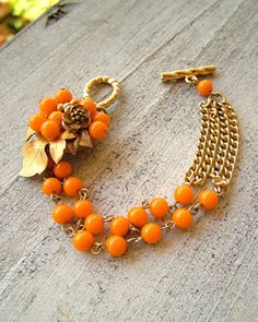 Orange Round Bead Bracelet (no tutorial) inspiration for how to recycle vintage items