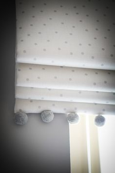 Beautiful nursery using Flohr & Co. fabrics www.flohrandco.com - Roman blind with pom poms