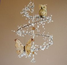 Pearl and Crystal Mobile Chandelier with Perched Owl and Butterfly - don't know where on earth it would go, but it purdy and looks easy enough to make :)