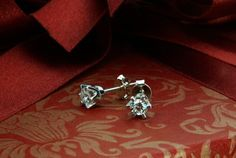 Ideal pair of white diamonds set in crown earrings.