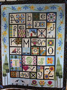 2014 BOM from The Quilt Show. I love all of Janet Stone's alphabet quilts - this one is lovely and clever too. I don't know all the pattern names but I see that most fit the letters. F for flying geese, B for baskets, W for windmill and so on. Quilt Baby, Quilt Kits, Quilt Blocks, Alphabet Quilt, Alphabet Blocks, Alphabet Soup, International Quilt Festival, The Quilt Show, American Quilt
