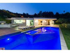 """Two linear fireplaces, a fully fitted """"Viking"""" BBQ and bar plus luxury Cabana area with Cinema Screen, projector and LED HD TV. 1161 Shadow Hill Way Beverly Hills, CA 90210"""