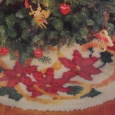 """WonderArt Latch Hook Tree Skirt Kit Christmas Poinsettia and Ribbons 33"""" Round New but box has some dings and creasing Just in time to make a treasured Christmas memory for your family."""