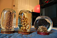Old fashioned mason jar snow globes. In this picture they aren't done - I put some cute ribbon around the bottom of them to make them pop out a little more! Snow Globes, Mason Jars, Ribbon, Pop, How To Make, Pictures, Ideas, Decor, Tape