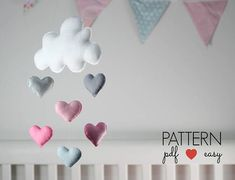 Cloud Baby Mobile or Wall Hanging Sewing Pattern - Create your own Cloud baby mobile for your babys nursery or to gift. Choose hearts, stars or raindrops, all three patterns are included. This mobile is stitched entirely by hand and is the perfect sewing pattern for beginners. Make in the