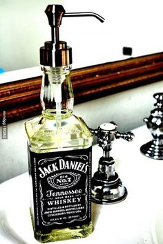 Cool DIY Projects Home Decor Idea! Glass Bottle Soap Dispenser made from an old Jack Daniels bottle| http://diyready.com/man-cave-ideas-19-diy-decor-and-furniture-projects/