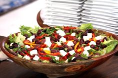 Tossed green salad topped with olives and peppers