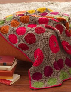 Circles Afghan, Large and small pop color circle motifs add a modern feel to this afghan: free crochet pattern