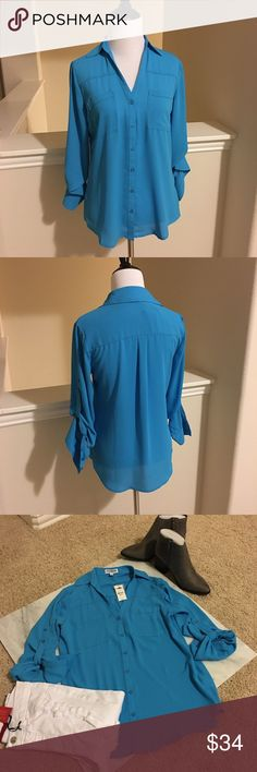 NWT Sky blue Express button down Sz XS NWT Express button down Portofino style shirt. In a beautiful sky blue color. Size XS. Sleeves can be worn long or buttoned up to a 3/4 length style. Beautiful shirt! Comes with extra buttons. Comes from a smoke free home. Express Tops Button Down Shirts