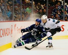 CrowdCam Hot Shot: Vancouver Canucks defenseman Andrew Alberts is boarded by San Jose Sharks defenseman Matt Tennyson during the third period at Rogers Arena. The San Jose Sharks won 3-2. Photo by Anne